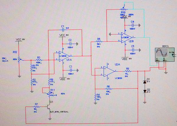 运放u1a组成三角波发生电路,输出的信号经过运算放大器u2b进行幅度